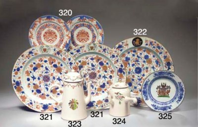 A pair of Imari armorial dishe