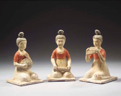 A set of three red pottery fig