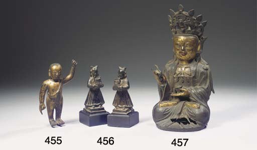 A late Ming bronze figure of G