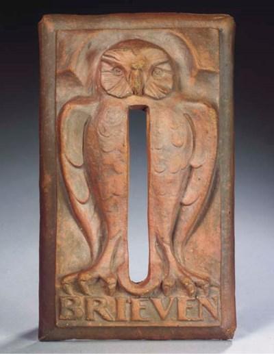 A terracotta figural letter-bo