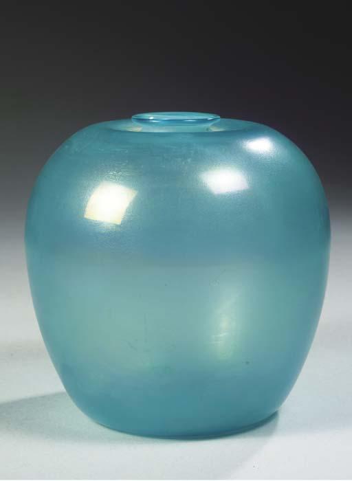 A LIGHT BLUE GLASS VASE