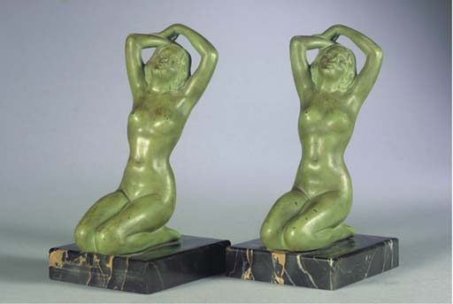 (2)A PAIR OF SPELTER BOOKRESTS