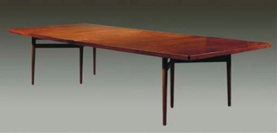 A cherrywood dining-table