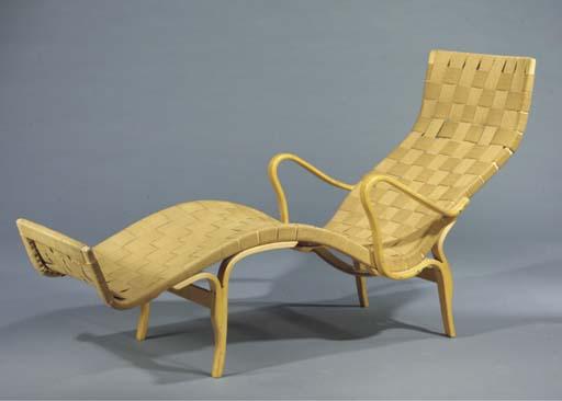 A wooden chaise longue