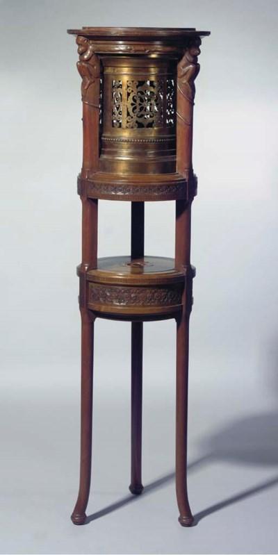 A rosewood inlaid mahogany and