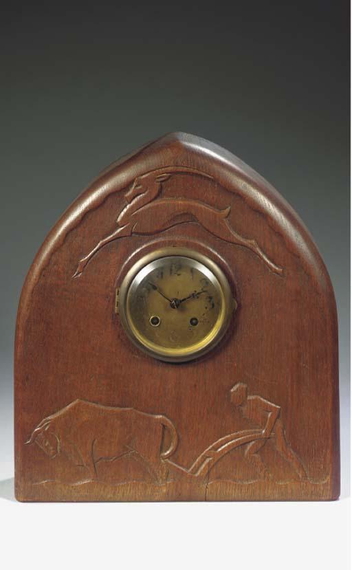 An oak mantle-clock