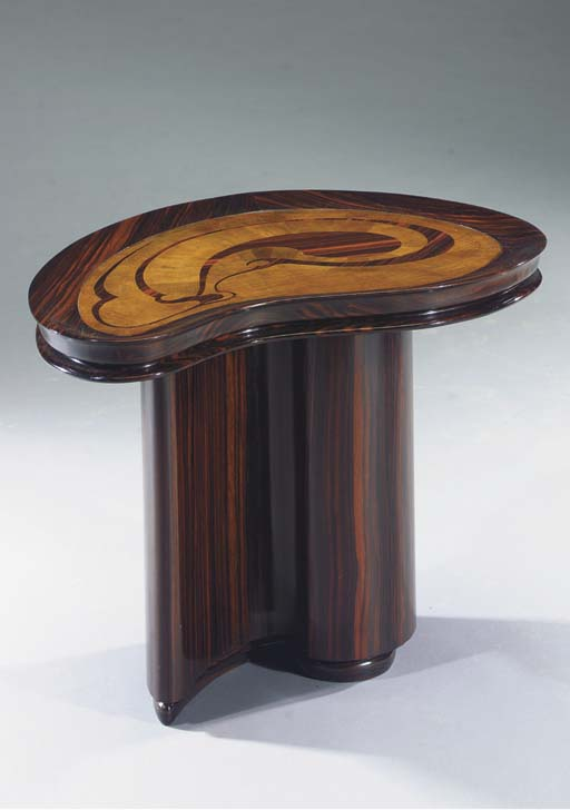 A rosewood and fruitwood centr