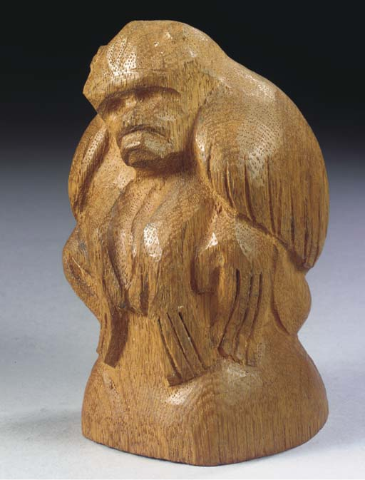 An oak figure of a sitting mon
