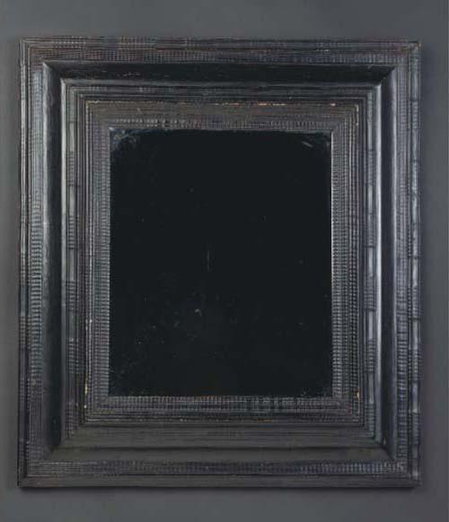 A Flemish ebonised frame