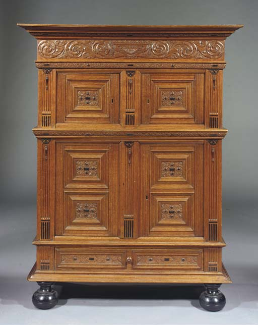 A Dutch oak and ebonised cupbo