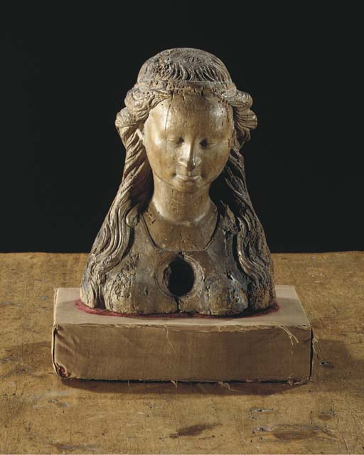 A CARVED WOOD BUST OF A FEMALE