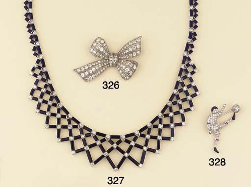 A DIAMOND, RUBY AND BLACK ENAM