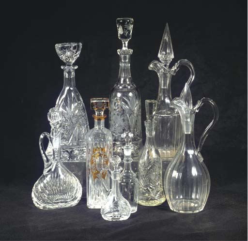 A collection of nine cut-glass