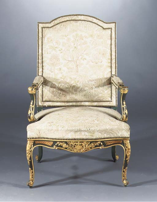 A PARCEL-GILT GREEN PAINTED FA