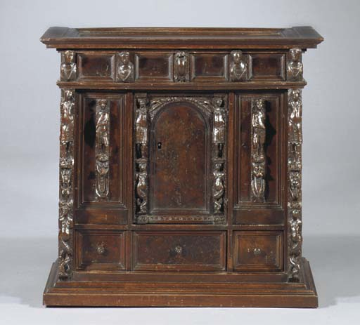 AN ITALIAN WALNUT CABINET
