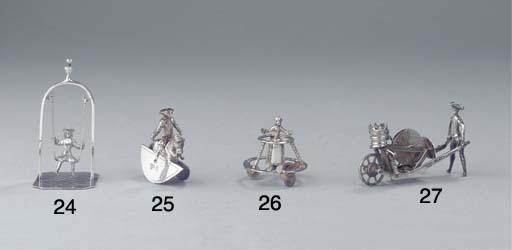A Dutch silver miniature child