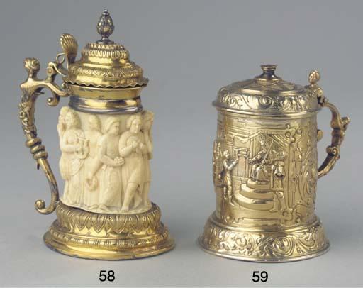 A metal-gilt and ivory tankard