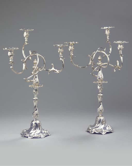 A pair of Dutch silver three-l