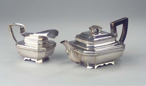 A Dutch silver teapot and milk