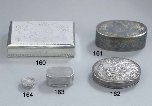 An oval silver-gilt niello box