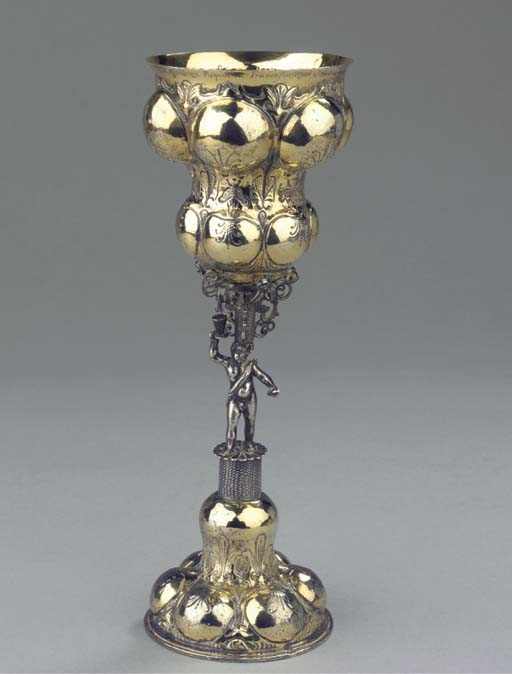 A German silver-gilt cup on fo