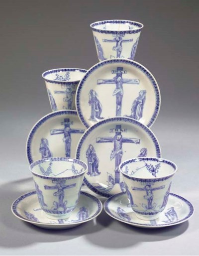 Four blue and white cups and f