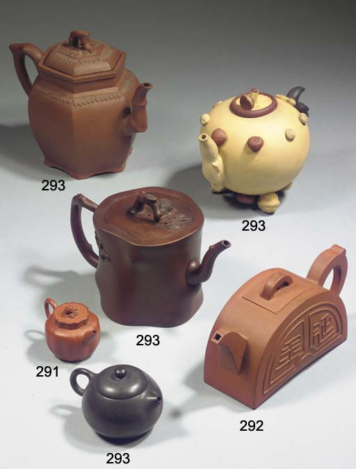 Three Yixing teapots and cover