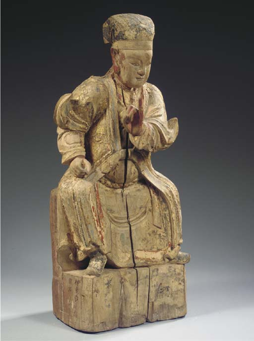 A wood polychrome sculpture of