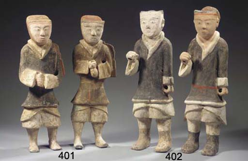 Two painted pottery figures of