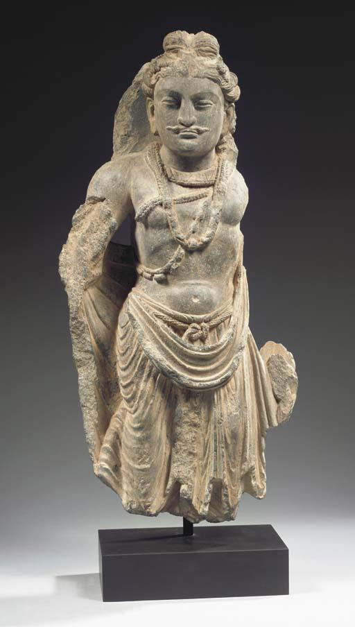 a gandhara schist figure of a