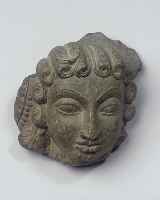 an indian stone female head
