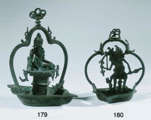 a javanese bronze oil lamp