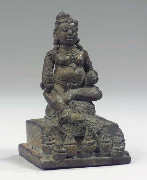 a javanese bronze figure of ku