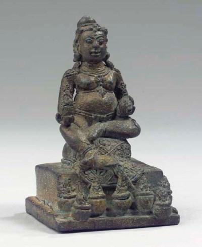 a javanese bronze figure of ku