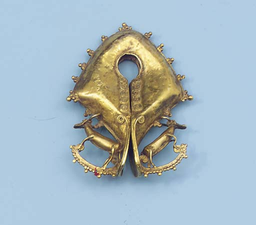a sumba low alloy gold pendant