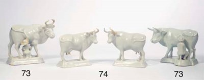 A pair of white Delft standing