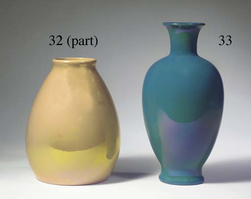 (3)  An iridescent creamwhite glazed pottery vase