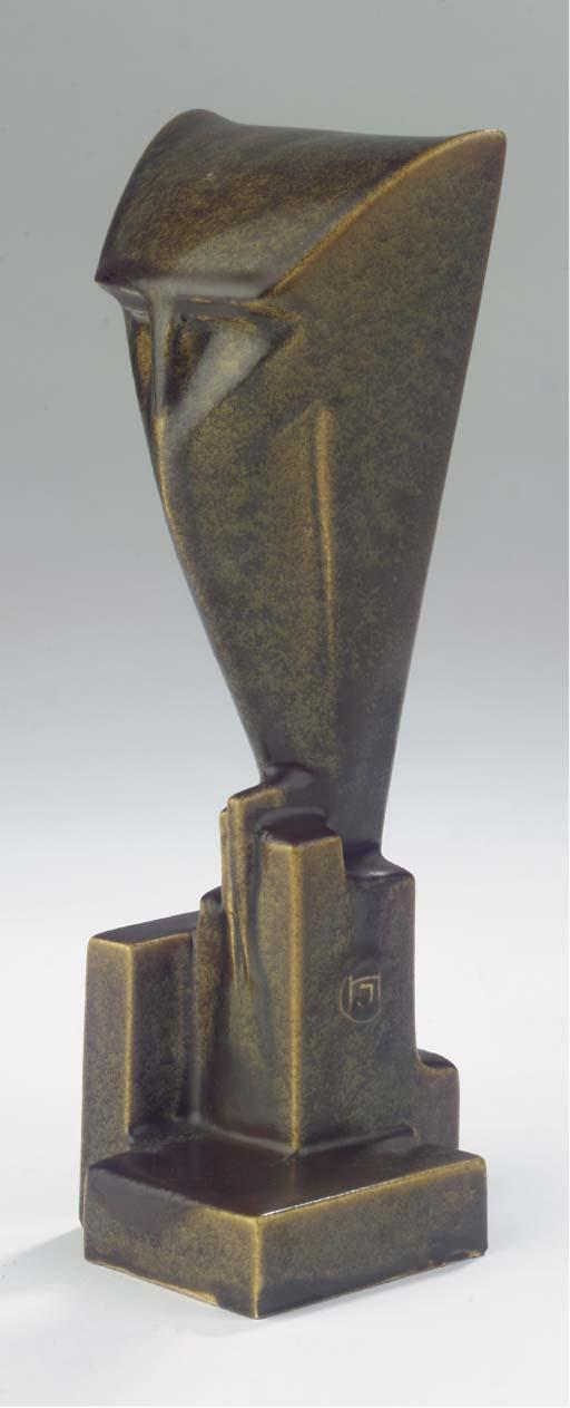 A green glazed pottery figure
