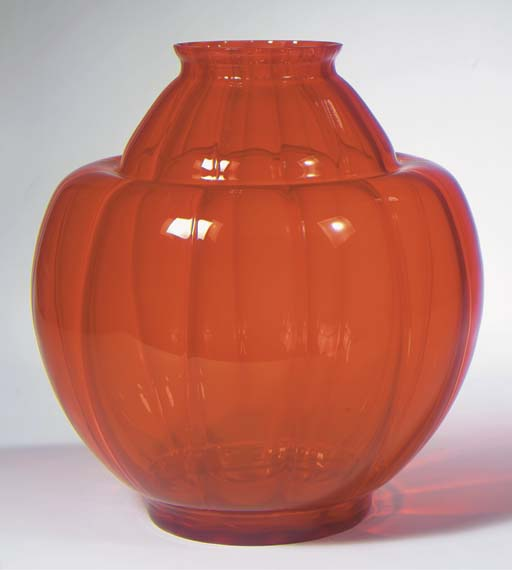 An orange glass vase