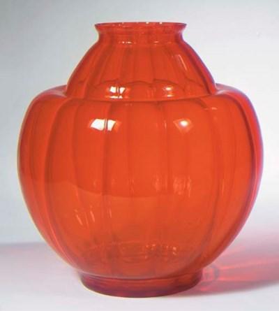 An orange glass vase