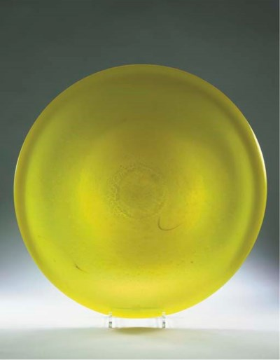 An Unica yellow glass dish