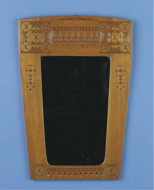 A carved walnut wall-mirror