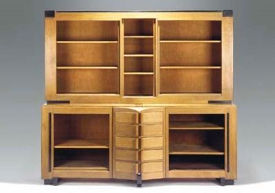 A partly ebonised oak bookcase