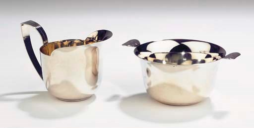 (2)  A silver creamset