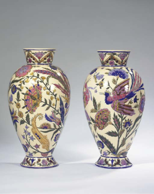 A pair of gilt and glazed pottery vases