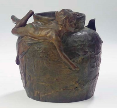 A patinated bronze vase