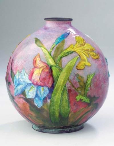 An enamelled brass vase