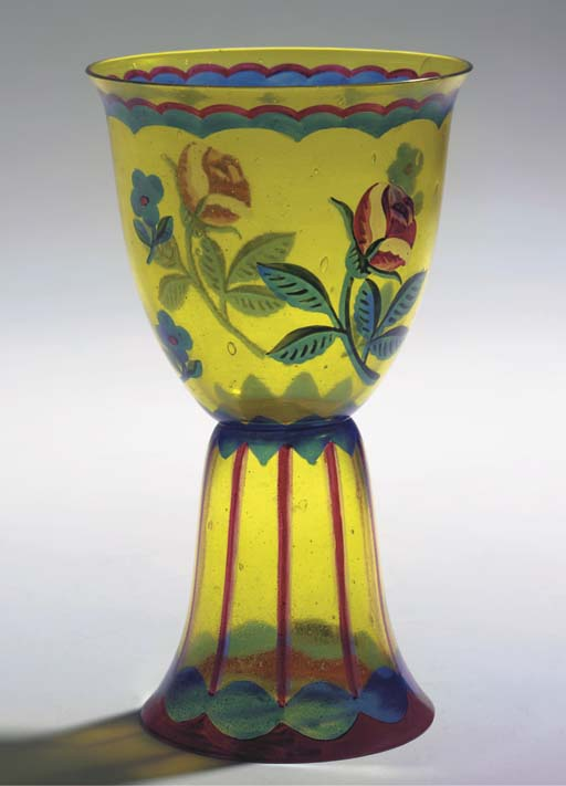 An enamelled yellow glass vase