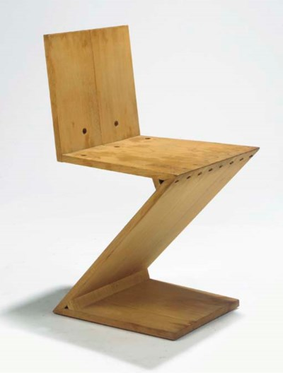 A wooden zigzag chair
