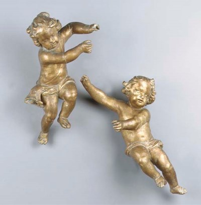 A pair of giltwood putti